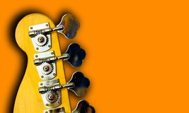 Bass Guitar. Top Of A Bass Guitar Isolated On Solid Background (with area for text royalty free stock photos
