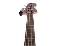 Bass Guitar. Perspective view looking up a bass guitar fingerboard to the headstock. Focus headstock Stock Images