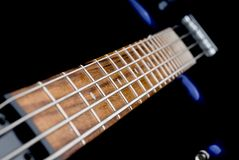 Bass guitar. Macro of a bass guitar neck stock photos