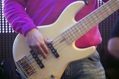 Bass guitar. A bass guitar player during acoustic concert stock photos