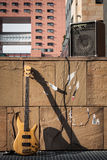 Bass guitar and amplifier against a wall Royalty Free Stock Photography