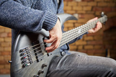 Bass guitar being played in a sound studio Royalty Free Stock Photography