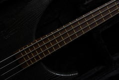 Bass guitar on the black Royalty Free Stock Photos