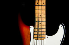 Bass guitar on black background Royalty Free Stock Image
