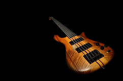 Bass guitar with black background Royalty Free Stock Image
