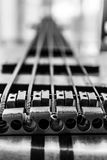 Bass guitar. Black and white capture of bass guitar strings as leading line stock photography
