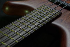 Bass guitar with brown body Royalty Free Stock Photography