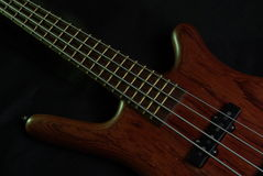 Bass guitar with brown body Stock Photo