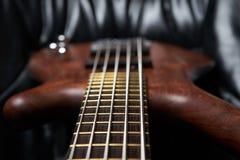 The bass guitar brown wood Stock Photo