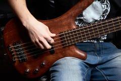 The bass guitar brown wood Stock Photos