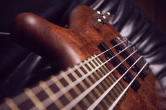 The bass guitar brown wood Royalty Free Stock Image