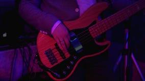 Bass Guitar close up. Man playing guitar at rock concert. 4k UHD video stock video