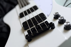 Bass guitar. Electric Black and white Bass Guitar Stock Images