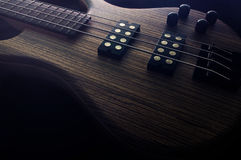 Heavy Bass Guitar. Heavy Rock Electric Bass with dark background stock images