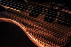 Heavy Bass Guitar. Electric Bass wooden with dark background royalty free stock images