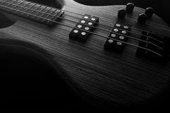 Heavy Bass Guitar. Heavy Metal Electric Bass wooden with dark background royalty free stock images