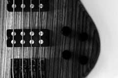 Heavy Bass Guitar. Electric Bass wooden detail, bridge and strings royalty free stock images