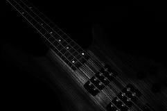 Heavy Rock Bass Guitar. Electric Bass wooden gear detail, dark backround Low Key Photo royalty free stock photo
