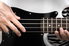 Bass guitar finger style closeup. Musical instruments - concept musical composition and creativity Stock Image