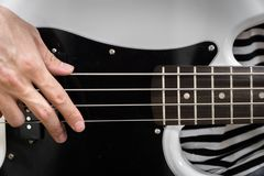 Bass guitar finger style closeup Royalty Free Stock Photo