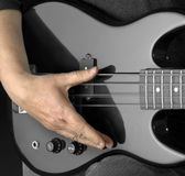 Bass guitar and hand Royalty Free Stock Photos