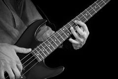Bass guitar in hands Royalty Free Stock Image