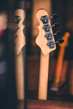 Bass Guitar Head and Neck Still Life. Vintage Effect. Royalty Free Stock Photo