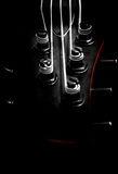 Bass guitar headstock (low key, shallow depth of field) Stock Images