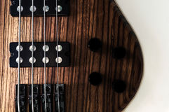 Heavy Bass Guitar. Heavy lectric Bass Wooden Detail, Gear and strings royalty free stock photography