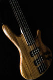 Bass Guitar. Heavy lectric Bass Wooden Detail, Gear and strings royalty free stock photo