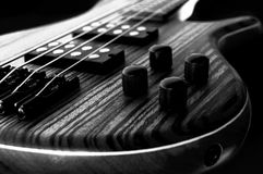 Heavy Rock Bass Guitar. Heavy lectric Bass Wooden Detail, Gear and strings, Black and White royalty free stock photography