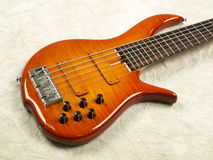 Bass guitar honey color body 2 royalty free stock image