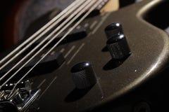 Bass Guitar II. Beautiful bass guitar whit 5 strings royalty free stock photos