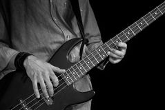 Bass-guitar In Male Hands Stock Image