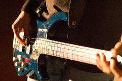 Bass Guitar. In Lights on stage Stock Image