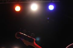 Bass Guitar. In Lights on stage royalty free stock photos