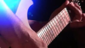 Bass guitar in live action at a concert - rack focus - close up. Playing bass - band playing on rock concert stock footage