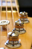 Bass guitar machine heads Royalty Free Stock Photos