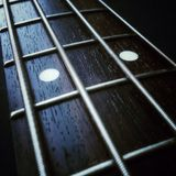 Bass guitar neck. Close up of bass guitar neck royalty free stock photo