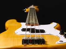 Bass guitar perspective. Photo of a electric bass guitar showing perspective from bottom to the headstock. Focus across middle Royalty Free Stock Photos