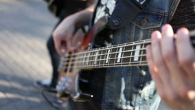 Bass guitar player close up playing virtuoso bass with fingers.  stock video footage