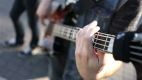 Bass guitar player close up playing virtuoso bass with fingers.  stock footage