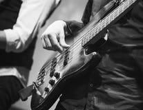 Bass guitar player, closeup photo Royalty Free Stock Photo