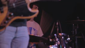 Bass guitar player and drummer stock footage