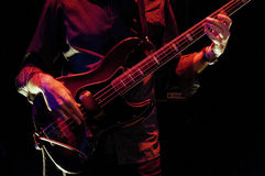 Bass guitar player. Live on stage Stock Photography