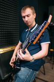Bass guitar player playing music, close-up Stock Photo