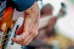 Bass guitar playing details royalty free stock photos