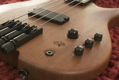 Bass guitar on red rug Royalty Free Stock Photos