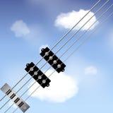 Bass guitar strings over sky Royalty Free Stock Photos