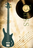 Bass guitar and vinyl record Royalty Free Stock Photos